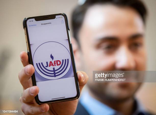 Committee member Leon Hakobian shows on his mobile phone a preliminary draft of a logo for a new Jewish grouping within Germany's farright AfD party...