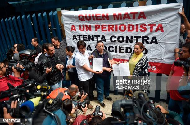 A committee of journalists from the state of Michoacan protest the May 18 disappearance of reporter Salvador Adame Pardo outside of the offices of...