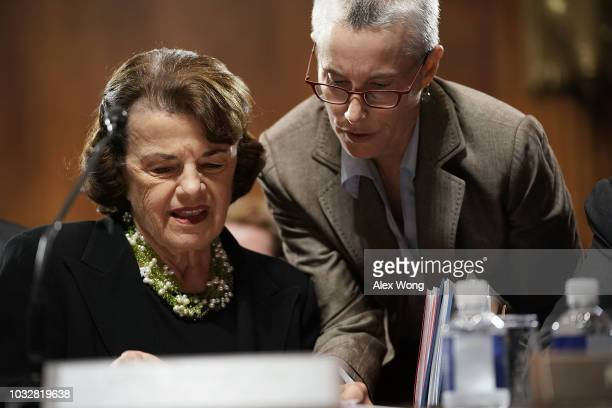 Committee ranking member US Sen Dianne Feinstein listens to an aide during a markup hearing before the Senate Judiciary Committee September 13 2018...