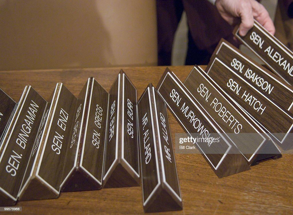 A committee staff member grabs Sen. Lamar Alexander's name plate to place at the Senator's seat as he arrives for the Senate Committee on Health, Education, Labor, and Pensions hearing on No Child Left Behind on Tuesday, March 6, 2007.