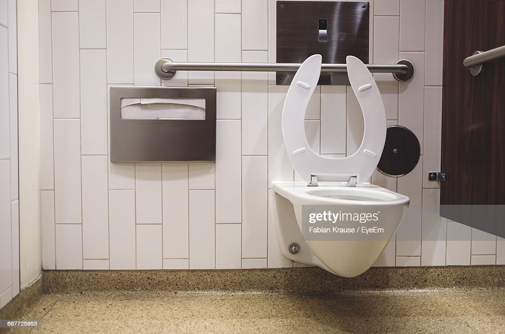 Commode Against Tiled Wall : Stock Photo