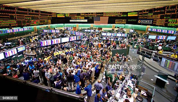 Commodity futures and options traders work on the floor of the New York Mercantile Exchange in New York US on Tuesday July 7 2009 US regulators say...
