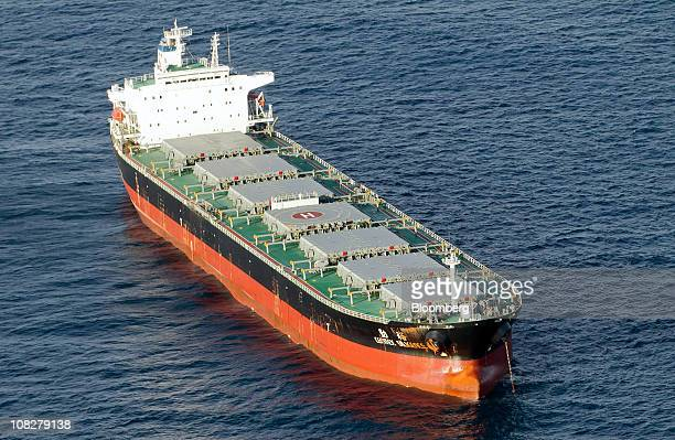 A commodity vessel waiting for a berth sits off the eastern coast of New South Wales in Newcastle Australia on Monday Jan 24 2011 Australia faces an...