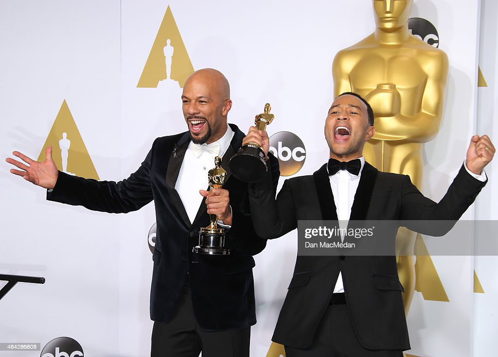 Common and John Legend pose in the press room with their awards for Best Original Song at the 87th Annual Academy Awards at Hollywood & Highland Center on February 22, 2015 in Los Angeles, California.
