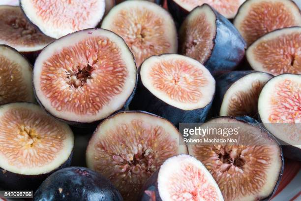 Common fig fruit close up of a transversal cut of the sweet delicacy Benefits of the fig include being rich in dietary fiber and manganese