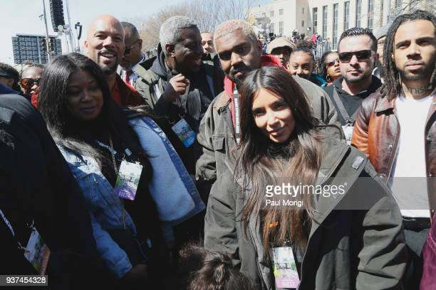 Common Kanye West and Kim Kardashian West attend March For Our Lives on March 24 2018 in Washington DC