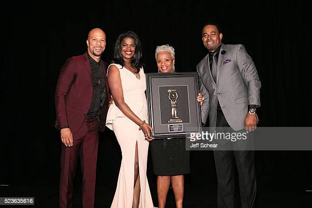 Common Kim Foxx a guest and Lamman Rucker attend the Common Ground Gala on April 23 2016 in Chicago Illinois
