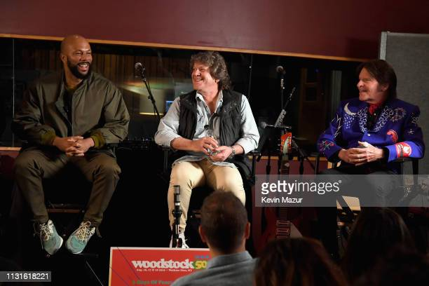 Common Michael Lang and John Fogerty speak on stage at the announcement of the Woodstock 50 Festival LineUp at Electric Lady Studio on March 19 2019...