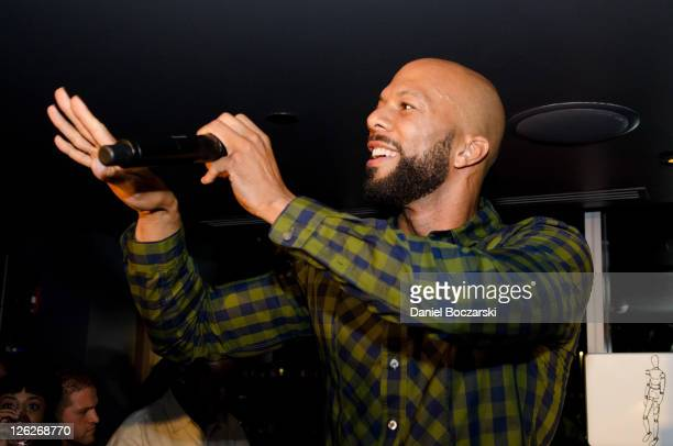 Common performs during the Moet Rose Lounge Chicago and Common's celebration of the launch of 'One Day It'll All Make Sense' at Roof The Wit Hotel on...