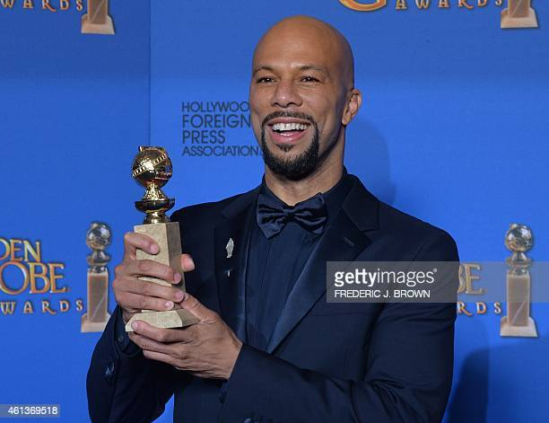 Common poses with the award for Best Original Song Motion Picture for Selma in the press room at the 72nd annual Golden Globe Awards January 11 2015...
