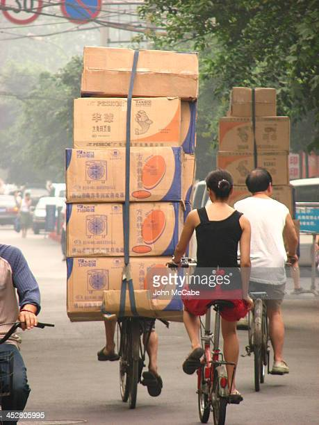 Common sight in developing countries is a bicycle carrying a load that seemingly is too large and unstable to be safely transported. This example is...