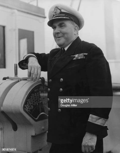Commondore Sir James Gordon Partridge Bisset captain of the ocean liner 'Queen Elizabeth' at the engine order telegraph on the bridge of the vessel...