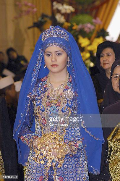 Commoner Sarah Salleh dressed in radiant blue is seen during her wedding to Bruneian Crown Prince AlMuhtadee Billah Bolkiah in this official handout...