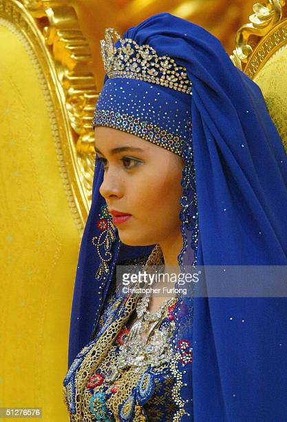 Commoner Sarah Salleh in radiant blue is seen during her wedding to Bruneian Crown Prince AlMuhtadee Billah Bolkiah at the Balai Singgahsana Indera...