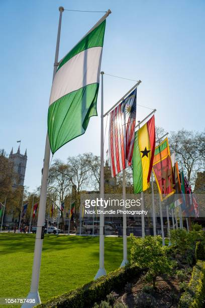 commonwealth flags, parliament square, westminster, london. - british empire stock pictures, royalty-free photos & images