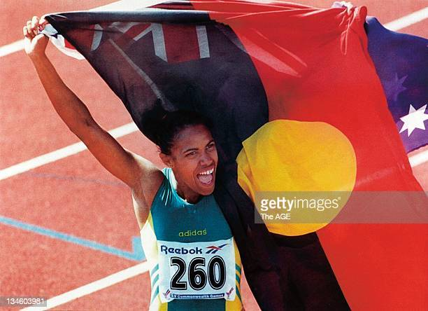 Commonwealth Games Exhibition 2006 An ecstatic Cathy Freeman celebrates her 400metres victory and her heritage by waving the Australian and...