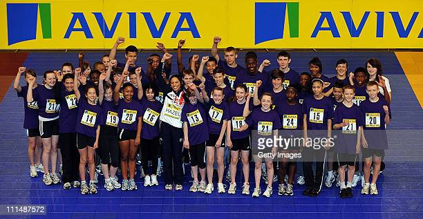 Commonwealth Heptahlon Champion Louise Hazel poses for photographs with the competitors from Birmingham during the Aviva UKA Academy Sportshall...