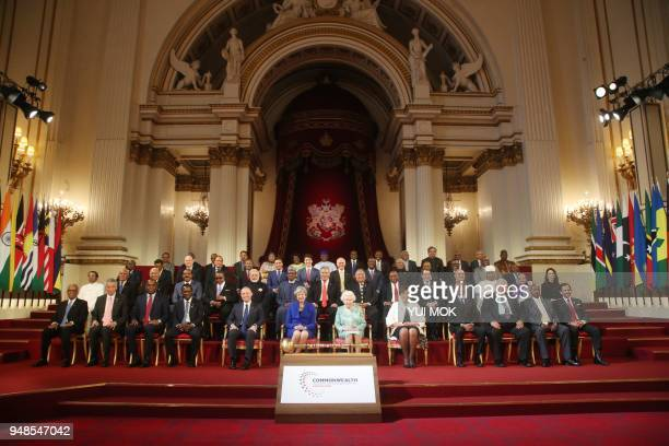 Commonwealth leaders pose for a family photograph with Britain's Queen Elizabeth II at the formal opening of the Commonwealth Heads of Government...