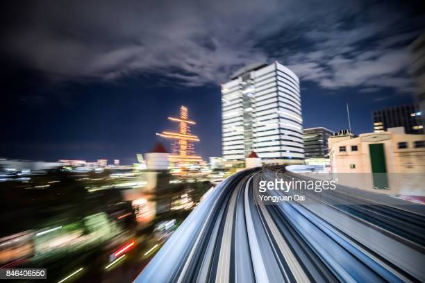 Commter Train Riding Through Tokyo at Night