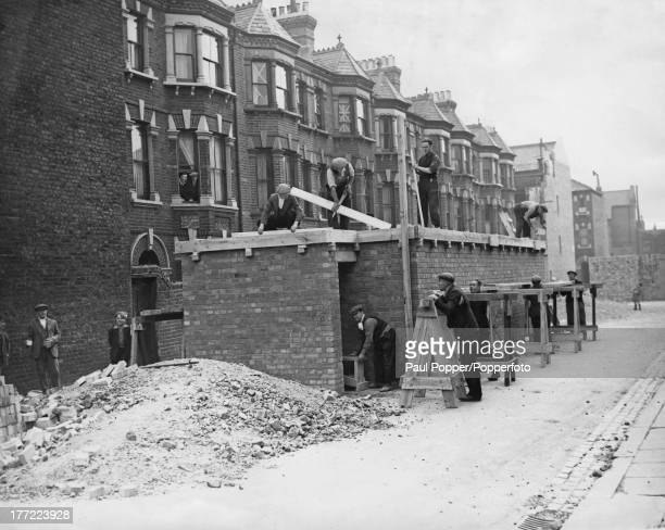 Communal air raid shelters under construction in a south London street at the outbreak of World War II 2nd October 1939 The shelters are brick with...