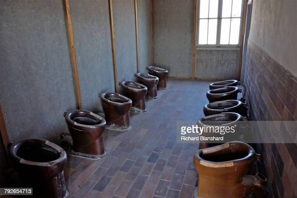 Communal latrines in one of the two reconstructed barracks at at the site of the former Dachau Nazi concentration camp in Bavaria Germany 2014 The...