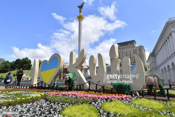Communal workers plant flowers at the Independence Square in Kiev on May 21 ahead of the 2018 UEFA Champions League Final football match between Real...