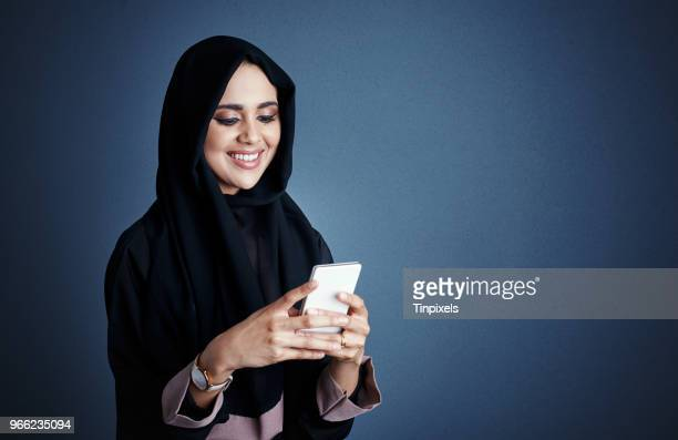 communicating via text - muslim woman darkness stock photos and pictures