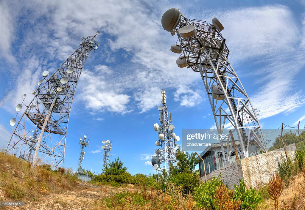 Communication antenna towers in fish-eye perspective : Stock Photo