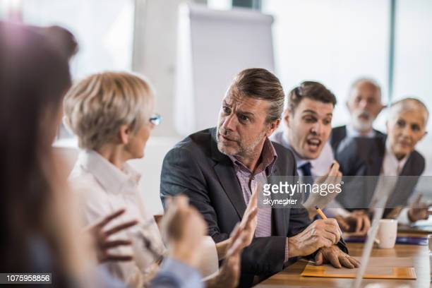 communication problems on a business meeting! - communication problems stock pictures, royalty-free photos & images