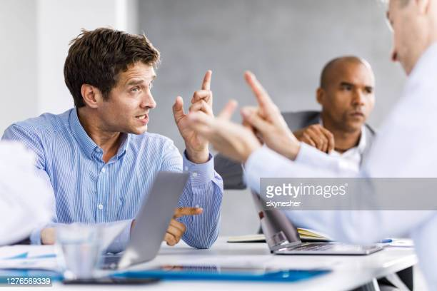 communication problems on a business meeting! - confrontation stock pictures, royalty-free photos & images