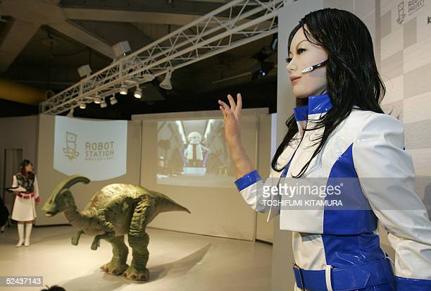 A communication robot 'Actroid' along with dinosaur robot tyrannosaurus are presented at the Robot Station during its press preview at the Aich Expo...