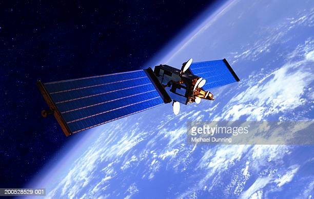 communication satellite over the earth - satellite view stock pictures, royalty-free photos & images