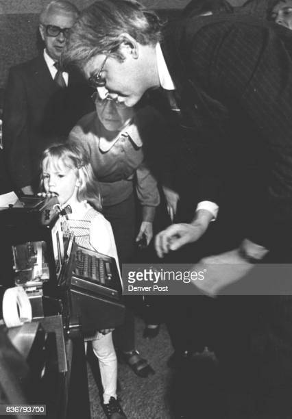 Communication System for Deaf Shown to Governor A deaf Aurora girl Norma Bowers shows Gov Dick Lamm a teletype machine receiver used by dead persons...