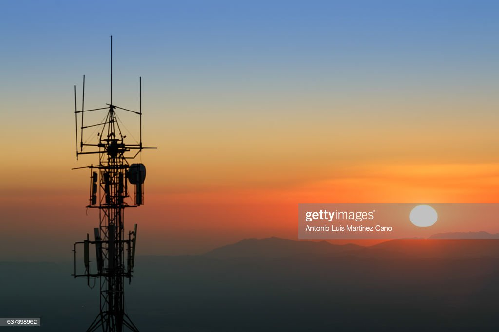 Communication tower at dusk : Stock Photo