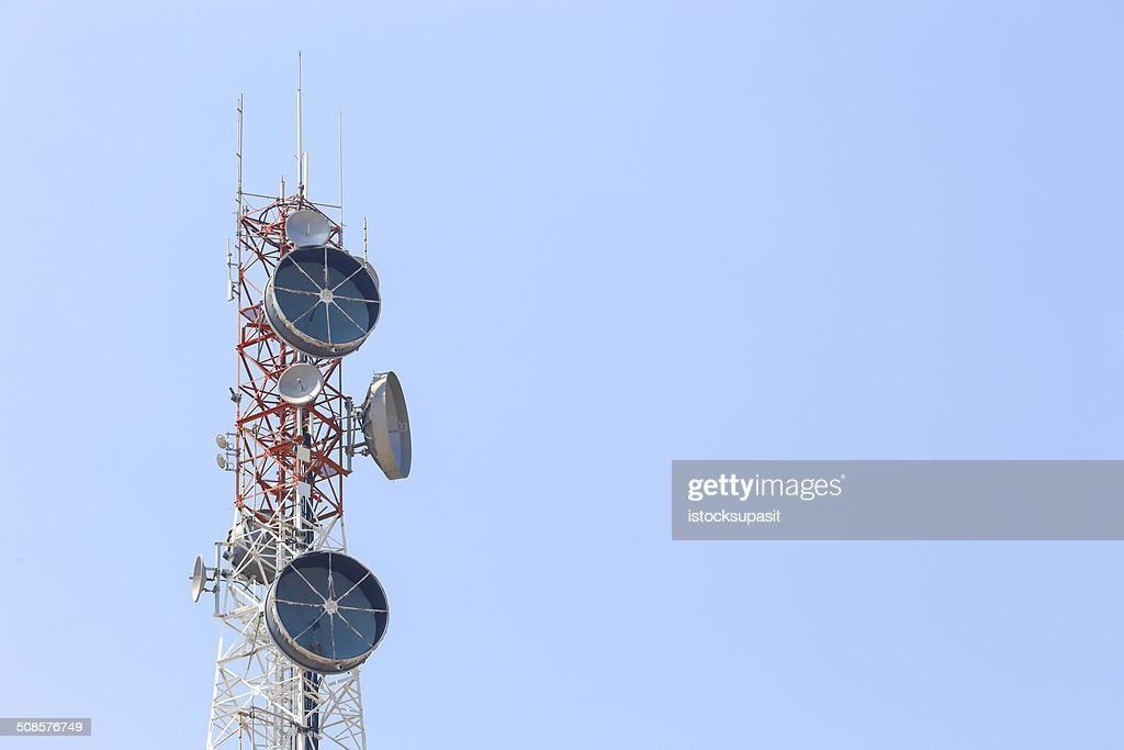 Communication tower over blue sky. : Stock Photo