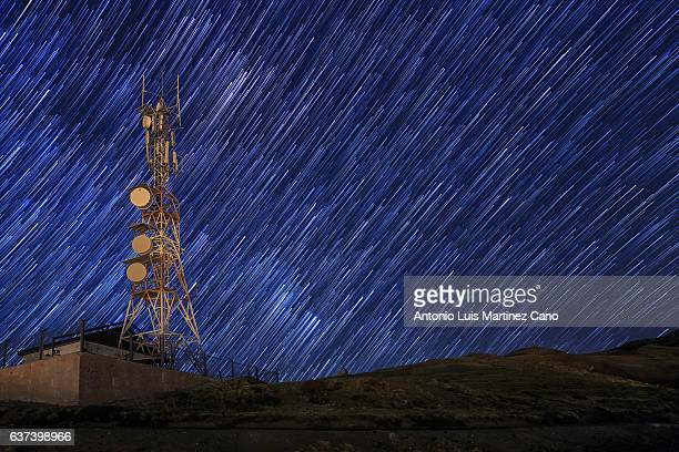 Communication tower with star trail.