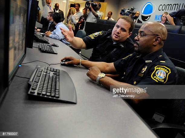 Communications clerk Angel Castro demonstrates the movements of a remote surveillance camera to Lt Darryl Martin in the newlyopened Surveillance...