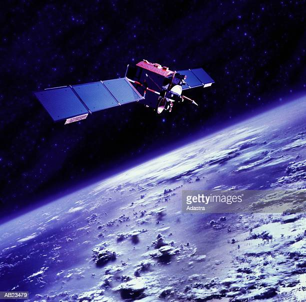 communications satellite orbiting above earth - space exploration stock photos and pictures