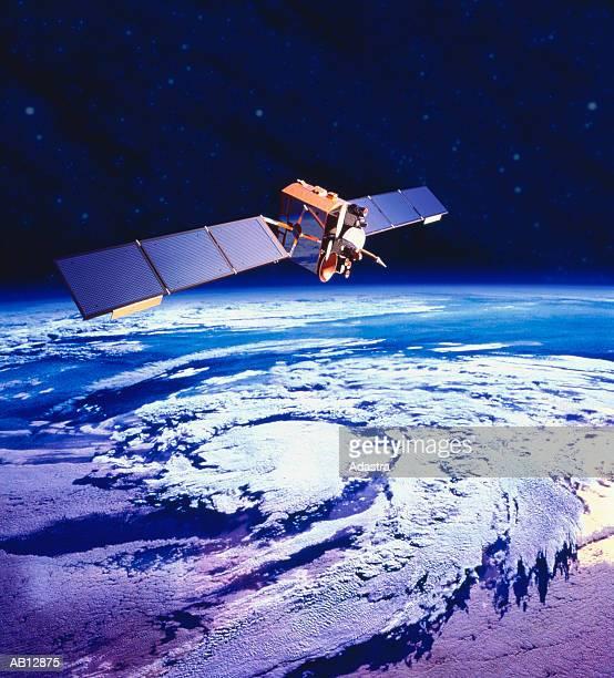 communications satellite orbiting earth (digital composite) - 人工衛星 ストックフォトと画像