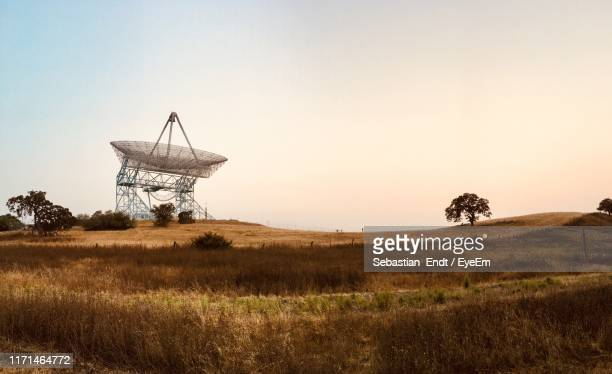 communications tower on land against clear sky - palo alto ストックフォトと画像