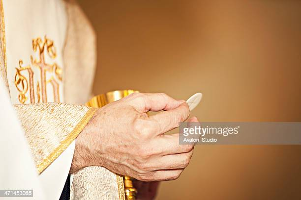 communion host - priest stock pictures, royalty-free photos & images