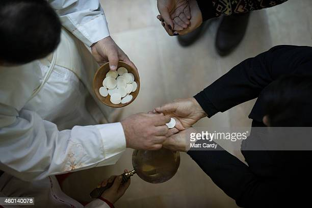 Communion is taken during Mass at St Joseph's Cathedral in the Ankawa district of Erbil which has become home to thousands of displaced Iraq...
