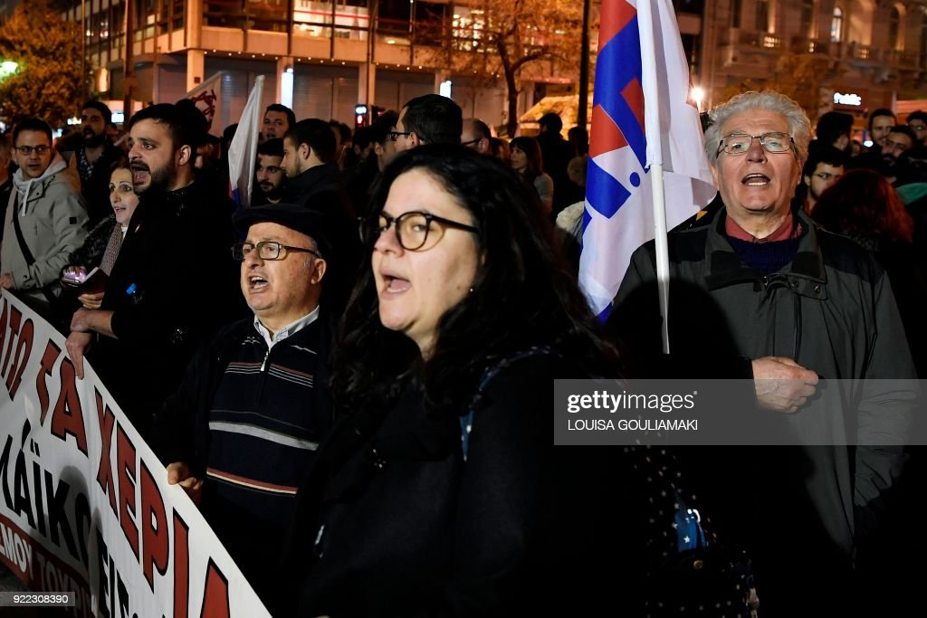 Communist affiliated protesters chant slogans as they march in central Athens on February 21, 2018 during a demonstration against property auctions demanded by Greece's creditors as part of the Greek austerity measures. Forced auctions of properties are seen as essential to restore Greece's banking system by its lenders. /