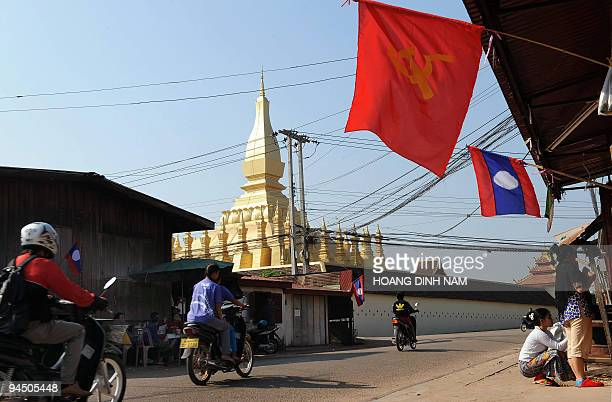 Communist and national flags are displayed outside residents' homes in downtown Vientiane on December 9 2009 Laos a landlock communist nation is...