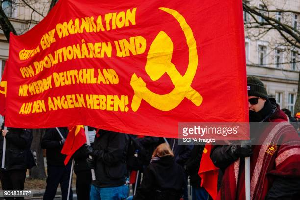 Communist banner seen at the Annual Liebknecht-Luxemburg left-wing demonstration in Berlin. Several thousand people recalled Rosa Luxemburg and Karl...
