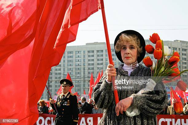 Communist demonstrator holds up a Soviet red flag during a May Day rally May 1 2006 in Moscow Russia Thousands of Russians gathered to celebrate...