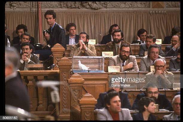 Communist deputies with caged dove placed on desk before President Ronald Reagan's speech to assembly.