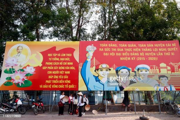 Communist government propaganda poster in the street Cai Be Vietnam