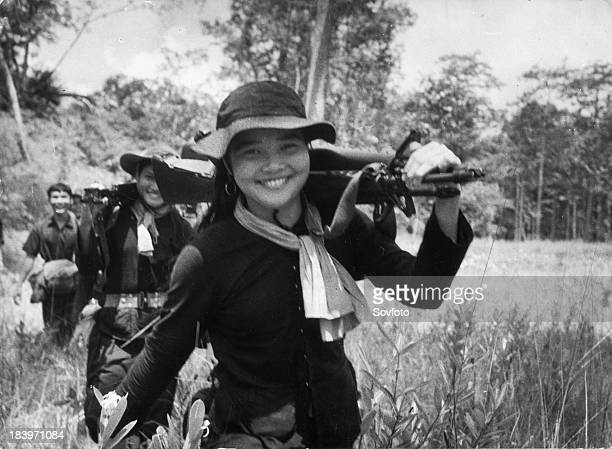 Communist guerrilla soldiers of the South Vietnamese Liberation Army returning from a successful misssion against US forces Vietnam War 1966