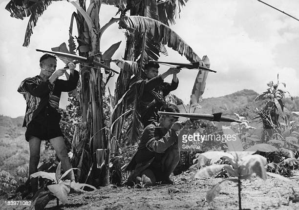 Communist guerrillas armed with crossbows and poisontipped arrows South Vietnam Vietnam War 1965